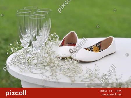 Wedding rings with wooden table on the grass background