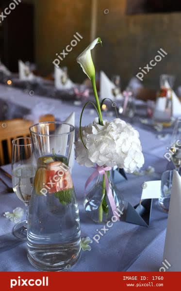 Wedding table setting decorated with fresh flowers