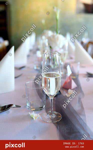 Wedding table with glass of white wine